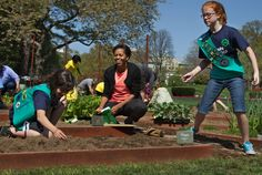 Michelle Obama gardens with Girl Scouts....pitches to recruit adult volunteers