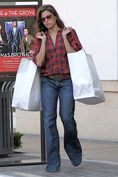 Eva Mendes in a checked shirt shopping in LA