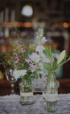 Lace, bottle, and wildflower centerpieces.