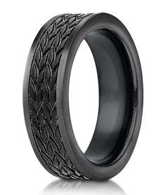 "Black cobalt chrome designer ring with ""tire tread"" pattern."
