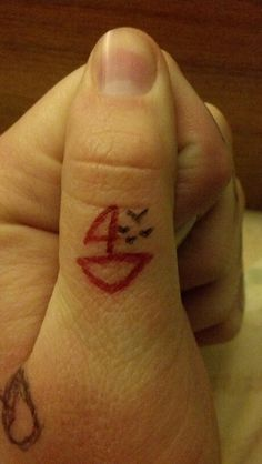 Tiny simple sailboat with little birds. Thumb tattoos. The boat looks a little sloppy. But if it got cleaned up a bit, I love the idea. And could be some better placement.