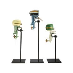 Enjoy this set of three painted aluminum Outboard Motor Replica Decor pieces to adorn a special spot on a book case or table. Once again, fun vintage model boat engines serve as inspiration to create something cool for your home or office. Flamingo Ornament, Lawn Lights, Boat Engine, Bird Statues, Outboard Motors, Distressed Painting, Desk Set, Vintage Models, Modern