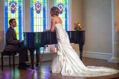 Bridal shot with Groom by piano at Willowood Ranch Chapel by tomK Photography