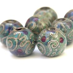 These beads are made of reactive 'Multicolor' glass, topped with spirals, squiggles and dots made with silvered ivory stringer. By Sarah Hornik Lampwork Glass Bead Set, Reactive Multicolor Glass with Silvered Ivory (7)