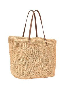 We're dreaming of the beach with this Straw tote bag.