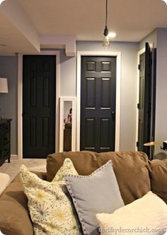 Hubby likes the color of these doors w/this room.....Basement projects contemporary basement