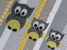 This funky little cot quilt is entirely made by myself in a modern palette of soft greys and yellow. This little quilt also has the addition of a cute family of owls, all stitched onto the quilt by hand using blanket stitch. This quilt would make a lovely present for an expectant mother or for your own nursery. It folds up to a compact size, making it ideal for taking in the car.    The dimensions of this quilt are 41 x 32 (104cm x 81cm)    The quilt features a simple modern design of…