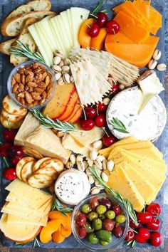 14 No-Cook Thanksgiving Appetizers That'll Keep Your Guests Happy Until Dinner 13 No-Cook Thanksgiving Appetizers That'll Keep Guests Happy Until Dinner: Cheese Board Party Platters, Food Platters, Charcuterie And Cheese Board, Cheese Boards, Cheese Board Display, Charcuterie Display, Slate Cheese Board, Easy Cheese, Thanksgiving Appetizers