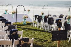 ceremony signage + hanging flowers in mason jars... so cute!