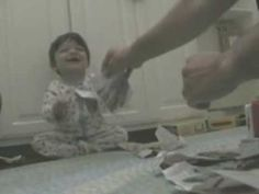 Baby Ripping Paper and Laughing