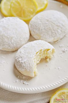 Tender, buttery Lemon Cooler Cookies are flavored with fresh lemon juice and generously coated with lemon-zest powdered sugar. Bursting with lemon! Lemon Desserts, Cookie Desserts, Just Desserts, Cookie Recipes, Delicious Desserts, Yummy Food, Baking Cookies, Meyer Lemon Recipes, Lemon Cookies