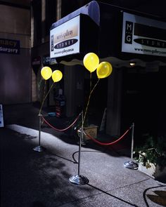 Trent Parke: the coloured balloons in the image really stand out, the yellow of the balloons contrasts against the grey of the building, creating an easy focal point for the audience. I think this image would convey a different message in black and white and maybe be not as engaging. The lighting has been positioned to fall over the entrance of the building and the balloons, emphasising the focal point.