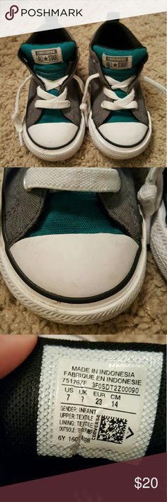 Converse 7T Color is gray and dark teal.  These are the kind you don't have to tie.  GUC due to some light scuffs on the white part of shoes.  It's not noticeable when wearing but these were worn and so not in brand new condition.  I haven't tried to wash at all. Converse Shoes