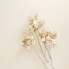 A personal favorite from my Etsy shop https://www.etsy.com/listing/237728884/bridal-hair-pins-ivory-flowers-pearl