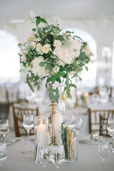 Candelabra with florals & foliage.