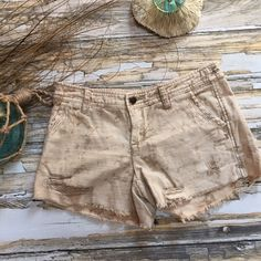 "Free People Destructed Tie Dye Shorts.  Size 0 Free Spirited Tie Dye Shorts.  Size 0.  Vintage Wash - Khaki Wheat Cream & Tan.  Heavily Destructed / Destroyed.  Raw Edge Hemline. Stitch Detail.  Inseam 3.5"".  Length 10"". Waist 28"".  Soft Brush Denim- 100% Cotton.  Very Good to Excellent Condition. Free People Shorts Jean Shorts"