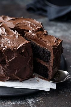 Best Chocolate Cake Recipe EVER - Dark chocolate cake with a rich and glossy (and not too sweet!) chocolate fudge frosting.