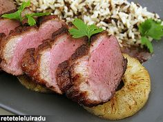 Duck breast with pineapple, a mixture of parboiled and wild rices and a pan sauce