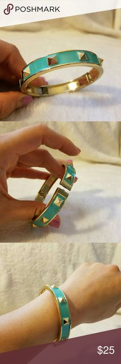 J. Crew Mint and Gold Bangle This cute bangle is in EXCELLENT condition, and the spring to open and close it is sturdy with a lot of give. It's a pretty bright touch to any outfit. J. Crew Jewelry Bracelets