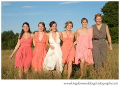 wrap bridesmaids dresses in various shades of orange - perfect for this Vermont summer wedding