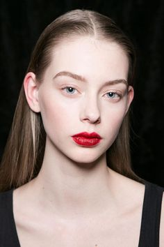 Soft, shiny center parts, rich red lipstick, and a touch of natural color on the cheeks at Cushnie et Ochs. | The Coolest Hair & Makeup Backstage at NYFW 2016