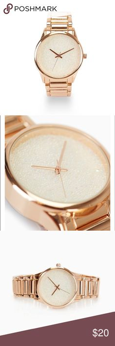 "Glitter Dial Watch in Rose Gold A dial watch featuring a clean faced bezel and a glittery display with a shiny metal chain link band. Rose Gold. Includes extra link.  1.25"" Diameter / 0.5"" Width Jewelry Clasp Closure Metal / Man Made Materials Imported Accessories Watches"