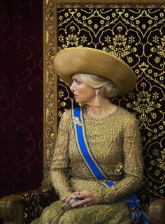 Queen Máxima wearing a gold dress by Jan Taminiau