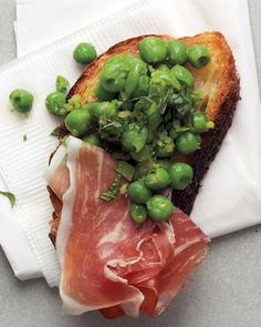 Mint pairs beautifully with the sweetness of bright green peas. Prosciutto is just icing on the crostini.