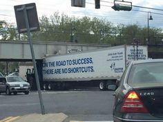 """""""Did ya git yer truck stuck?"""" """"Nope I was delivering that overpass and ran outta gas! Heere's yer sign!"""" - Bill Engvall"""
