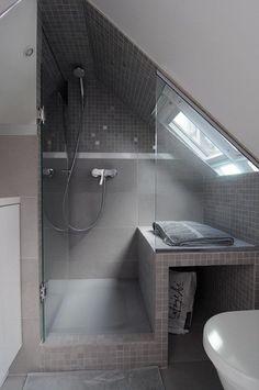 Beautiful gray tiled shower in a small attic #DIYAtticRemodel