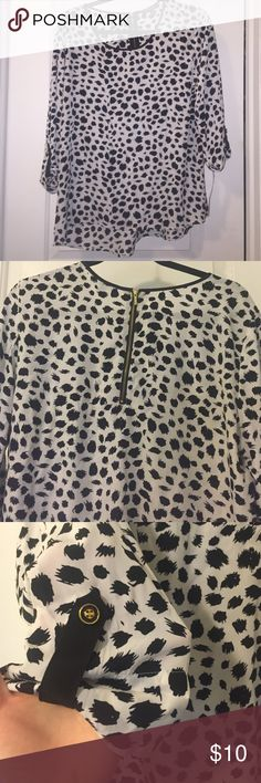 New with tags flowy black & white blouse w gold Gold accented hardware on the back zipper and adjustable roll up sleeves compliment the classic black and white patterned WITH TAGS blouse Tops Blouses