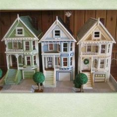 """1st Runner Up: Victorian Row Houses """"This made entirely from gingerbread. It weighs about 80 pounds and measures 28 inches by 18 inches by 18 inches. It took a little more than two months to build. The houses feature shiplap and individual pastillage shingles. The windows are gelatin sheets, and the inside figures are made of marzipan. The trees are fondant rolled in granola, then covered in royal icing."""" Russ R. Orinda, CA"""