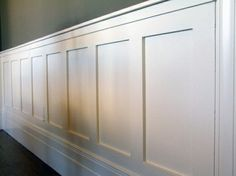 Wainscotting - clean lines with transitional aspect.  Not modern, not traditional.  This might be perfect.