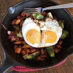 """""""I had a serious craving for eggs today!  Sweet potatoes, Brussels sprouts and radishes fried then baked with some of my autumn spice blend. Then fried two free range, soy free, organic eggs in coconut oil and devoured every bite of this!! #paleobreakfast #freerangeeggs @lodgecastiron #healthybreakfast #eattheyolks"""" Photo taken by @paleohope on Instagram, #paleohope"""
