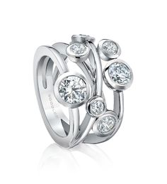 <p>A contemporary diamond ring from Boodles' Raindance collection</p> <ul> <li>Set with a certificated round-brilliant cut diamond of 0.70ct</li> <li>A further 1.39ct of diamonds</li> <li>In platinum</li> </ul> <p>Width: 18mm (approx.).</p>