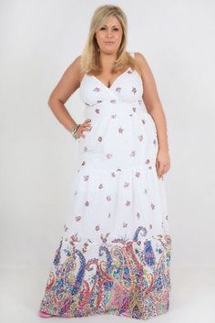 Glossy pink-lipped lightly tanned lady in shoulderlength honey hair, sleeveless sweetheart white maxi gown w/ fine floral print & paisley hem #healthysize