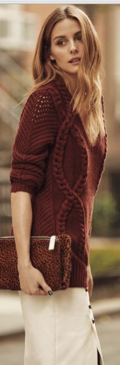 Who made  Olivia Palermo's red braided sweater and leopard clutch handbag?