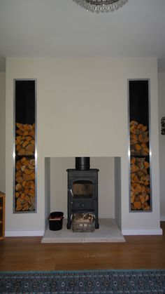Clearview Pioneer set upon a Bathstone hearth with integral log stores installed to a bungalow up a quiet lane in Wrecclesham, Farnham, Surrey. Clearview Stoves, Log Store, Wood Burner, Hearth, Bungalow, Farnham Surrey, Living Room, Fireplaces, Interiors
