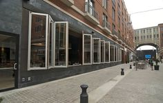 operable glass wall restaurant | Folding Glass Wall Systems
