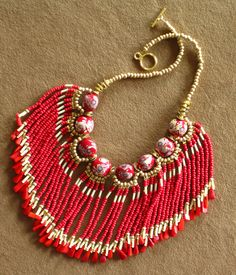 Native American style red, cream and gold fringed beaded necklace with red porcelain beads and coral