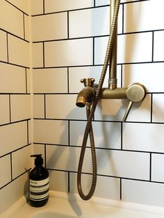 Antique brass bathroom fittings in vintage style, white metro tiles, pharmacy Aesop. House visit: Our bathroom of blue brass tiles. Metro Tiles Bathroom, White Bathroom Tiles, White Subway Tiles, Downstairs Bathroom, Bathroom Renos, Bathroom Interior, Wall Tiles, Bathroom Ideas, White Tiles Black Grout