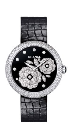Chanel Mademoiselle Privé Bouton de Camellia watch in white gold, with a black Grand Feu enamel dial decorated with the Bouton de Camellia motif in diamonds. The case is set with 552 brilliant-cut diamonds.