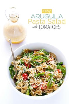 Easy-Arugula-Pasta-Salad-with-Tomatoes-Arugula Pasta Salad - The Easiest Salad you'll ever make. Plus it uses up all those leftovers in the fridge! #pastasalad #leftovers #pasta | Littlespicejar.com