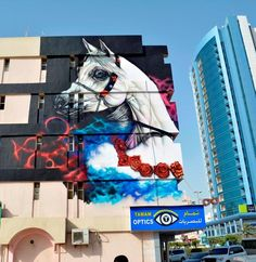 The Ajman Murals project in the United Arab Emirates welcomes a brand new street art piece in the City Center with this artwork by the muralist Ramy El Zaghawy. Painting under the intense heat, the Egyptian artist brought to life some of his signature imagery which will be enjoyed by the locals for years to come. #Streetart #Murals #TheAjmanMurals #RamyElZaghawy #UAE