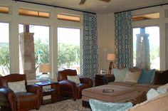To work with the existing sectional in this family room, I brought in a fabulous shag rug, colorful pillows and some pattern in the drapes.