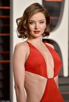 Daring: The bold dress boasted a plunging neckline and cut out panels, leaving her trim torso on show