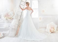 Nicole romantic redingote dress with beaded rebrode lace.