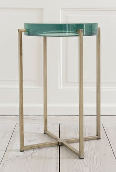 McCollin Bryan, 2000s, United Kingdom     Tinted lens table with acrylic top and brass base.     H59  x  Dia35 cm