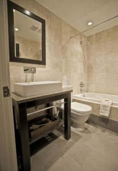 modern bathroom marble tile walls and ceramic tile floor european toilet square raised sink