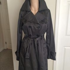 Bebe Trench Coat🌷 Black and White Striped Satin.  Please view my entire closet. Most of what I have are Brand Name items listed at over 70% OFF its original price. Most of what I offer are Brand New, Never worn Items. Most items that are not new are still in great condition. You will get a great deal on any of the 400 plus items I have listed.  Thank you! bebe Jackets & Coats Trench Coats